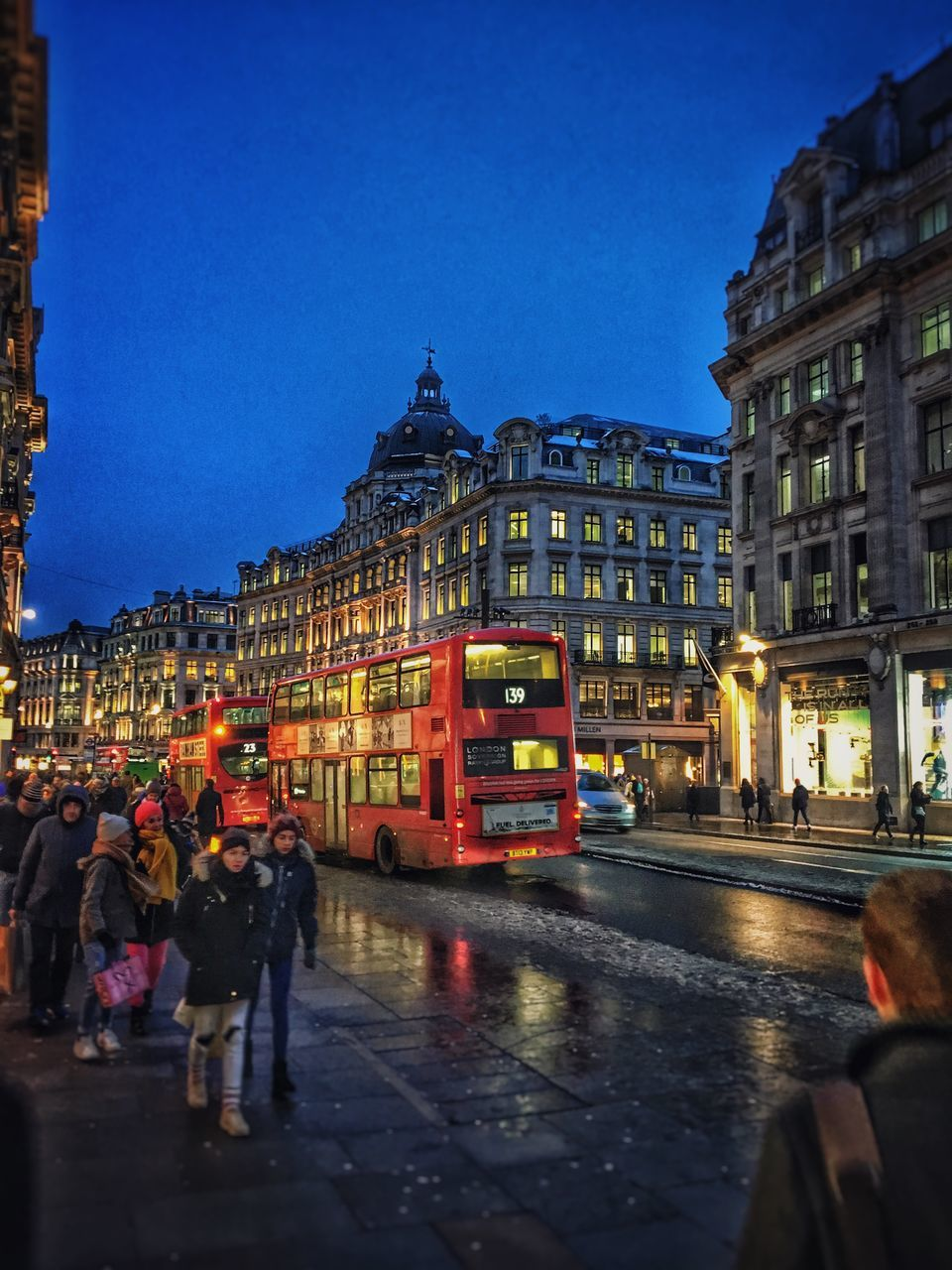 building exterior, architecture, built structure, city, building, street, illuminated, real people, sky, dusk, nature, group of people, city life, transportation, clear sky, women, blue, wet, men, night, outdoors, rain