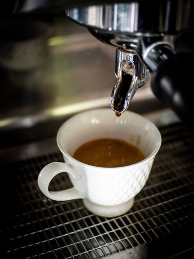 Close-up of coffee cup on machine