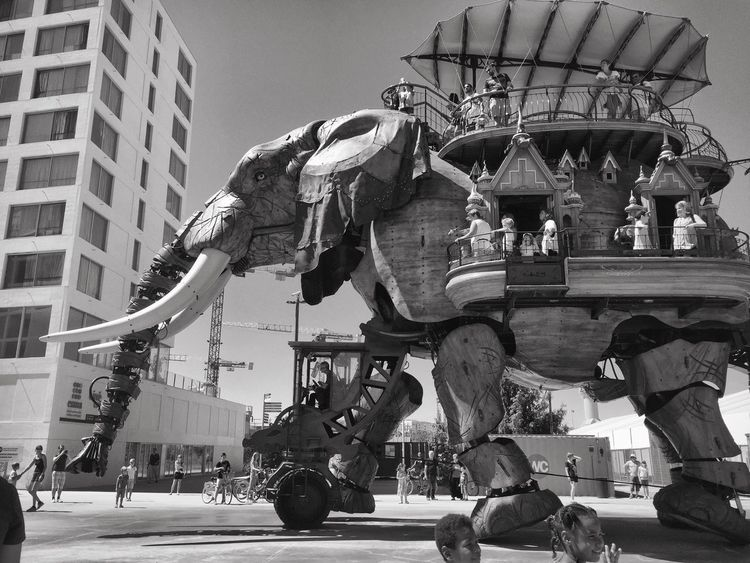 Streetphotography The Week On EyeEem Les Machines De L'ile City Life The Way Forward Outdoor Photography Street People Low Angle View Art Bnw_collection Black And White Photography Bnw Architecture Mechanical Art Ornate Wooden Structure Wooden Art Sculpture Focus On Foreground Tourism Elephant Monochrome Photography