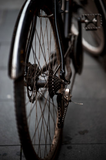 Close-up of bicycle on sidewalk