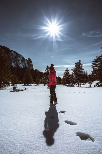 Winter Cold Temperature Snow Leisure Activity Real People Full Length Sky One Person Lifestyles Field Nature Land Sunlight Warm Clothing Winter Sport Tree Clothing Mountain Sun Outdoors Lens Flare People People Watching Hiking Sunbeam International Women's Day 2019