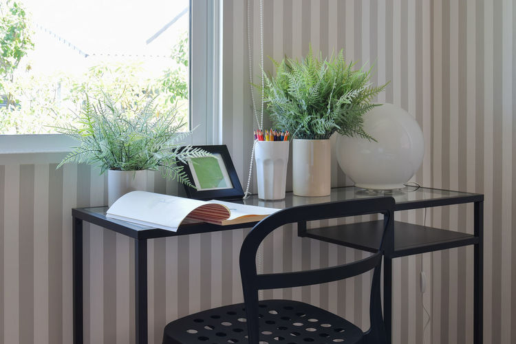 colorful pencils and sketchbook on black table Plant Table Chair Window Indoors  Day No People Seat Nature Potted Plant Absence Furniture Home Interior Home Houseplant Curtain Still Life Domestic Room Home Showcase Interior Coffee Table Flower Pot