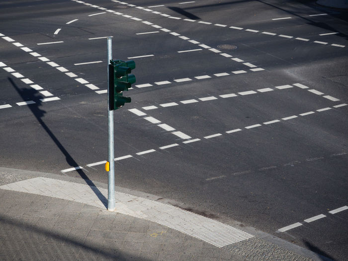 High Angle View Of Traffic Light On Empty Road Intersection
