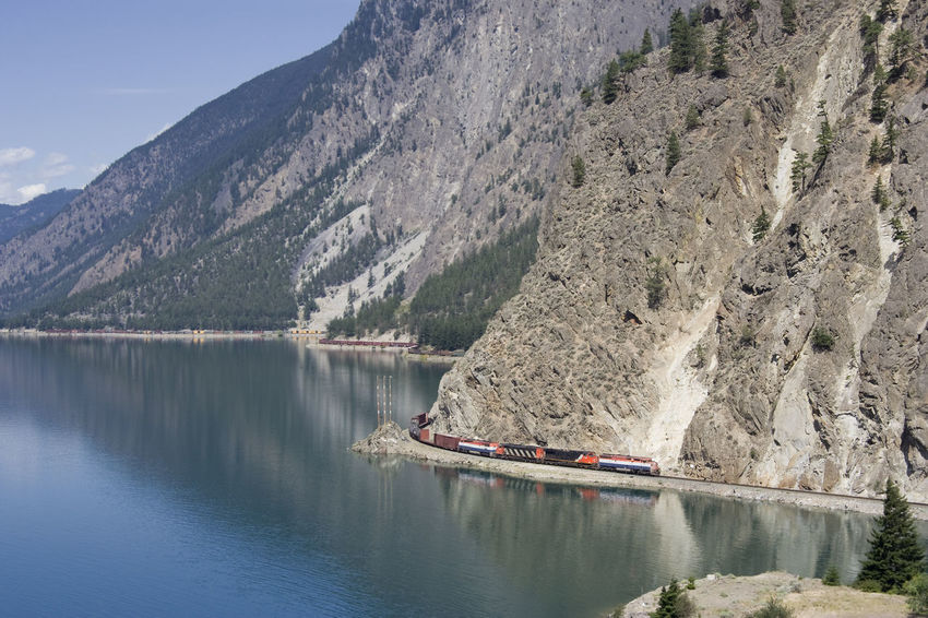 Long Freight Train - Canadian Pacific Railway on Seton Lake, British Columbia, Canada Beauty In Nature British Columbia Canada Canadian Pacific Railway Freight Train Freight Transportation Lake Lake View Lakeshore Landscape Landscape_Collection Landscape_photography Lillooet Locomotive Mountain No People Railroad Railroad Track Seton Lake Shipping  Squamish Traffic Train Transportation Water