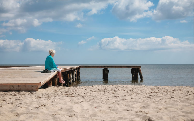 Contemplation Poland Sitting Outside Sopot, Poland Youth Beach Beauty In Nature Cloud - Sky Contemplating Elderly Horizon Over Water Old Age Old Woman One Person Outdoors Real People Rear View Retirement Sea Senior Adult Sitting Alone Sky Solitude Tranquil Scene Tranquility