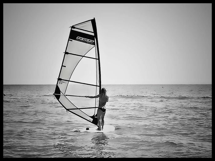 WIND OF SUMMER Sea Horizon Over Water Beach Outdoors Blackandwhite Photography Streetphotography Windsurf Fotografia Windsurfer Bnwphotography Travels Holidays Girl Surfers Surferslife Spiaggia Summer Peacefull Goodvibes Ontheroad