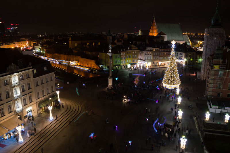 Poland Warsaw Europe Building Exterior Architecture Night City Illuminated High Angle View Built Structure Group Of People Street Travel Destinations Large Group Of People Crowd City Life Transportation Real People Building Nature Road Cityscape Outdoors Nightlife