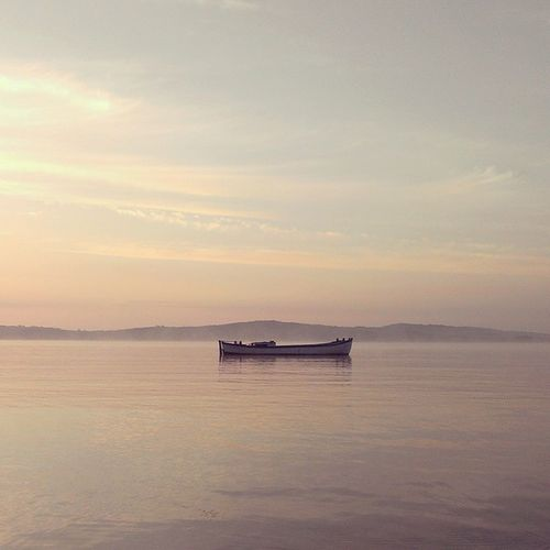Beauty In Nature Boat Calm Horizon Over Water Idyllic No People Non-urban Scene Outdoors Sea Sky Sunrise Tranquility Water