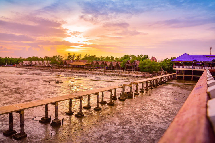 Beach at Samut Sakhon Thailand,Beautiful sunset nature background Architecture Beauty In Nature Building Building Exterior Built Structure Cloud - Sky Nature No People Orange Color Outdoors Plant River Scenics - Nature Sky Sunset Tranquil Scene Tranquility Tree Water