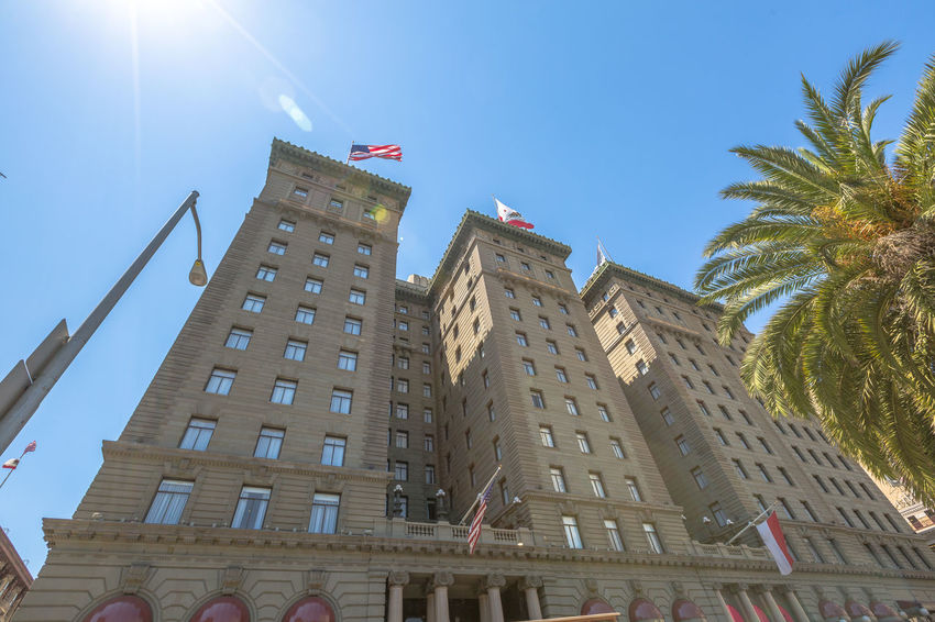 San Francisco, California, United States - August 17, 2016: close up of Westin St. Francis luxury hotel on popular Powell Street near Union Square in downtown San Fancisco. Perspective bottom upwards. Cable Car California Market SF San Francisco Square Union Union Square SF United States Architecture Building Exterior Built Structure City Clear Sky Day Flag Low Angle View Market Street San Francisco Market Street No People Outdoors Patriotism Sky Street Sunlight Tree Union Square  Unionsquare