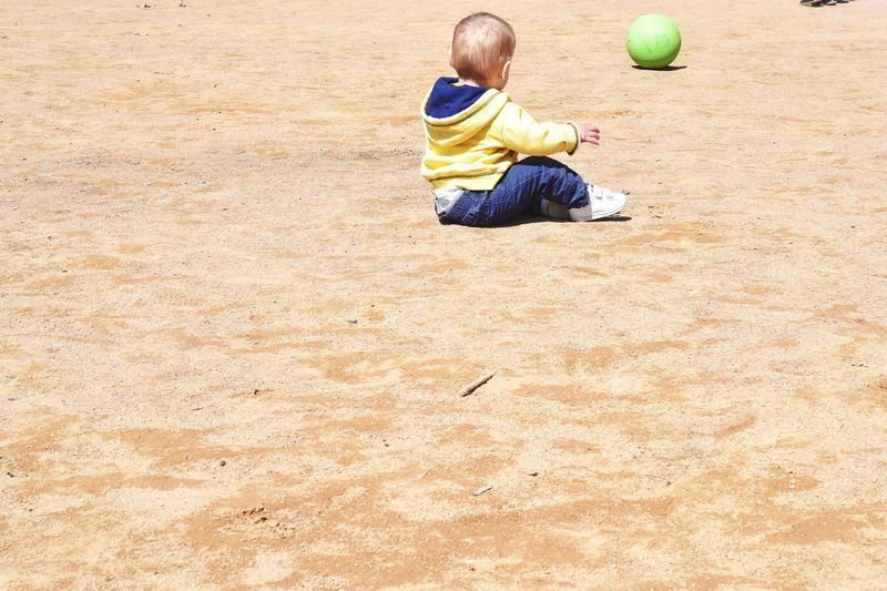 Baby boy playing with ball at playground