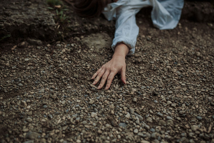 Womans hand on ground