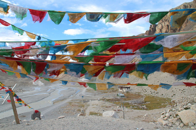 View of mountains with the sutra streamers from Everest Base Camp, Tibet. Architecture Day Flag Float Hanging Mountain Multi Colored No People Outdoors Sky Sky And Clouds Tibetan Culture Tibetan Prayer Flags