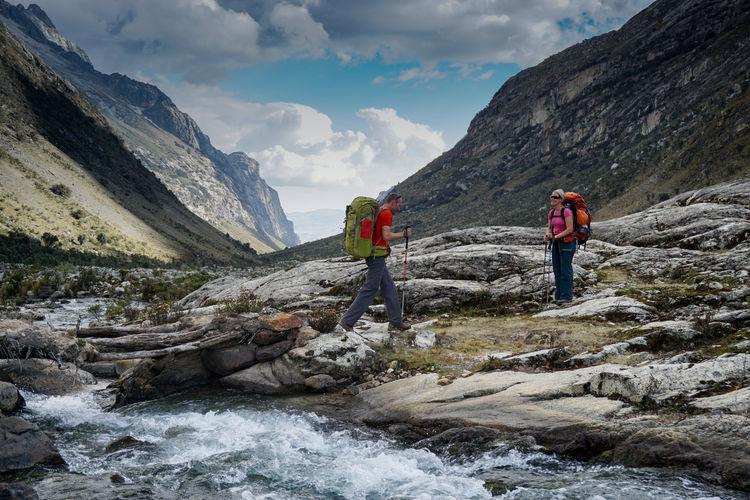 People walking on rocks