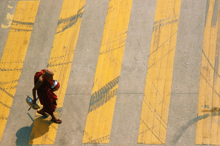 High angle view of monk walking on road