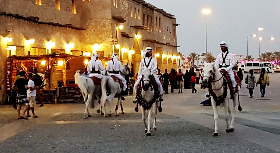 Horse patrol at traditional market City Architecture Horse Riding Adapted To The City Souq Waqif White Color Transportation Patrolling Travel Samsungphotography Streetphotography Riding Horse Building Cityscape City Location Stories From The City