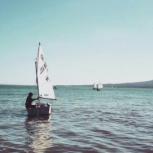 My son in his boat Boy Sailing Ocean Auckland New Zealand Kohimarama Boat Minimalist