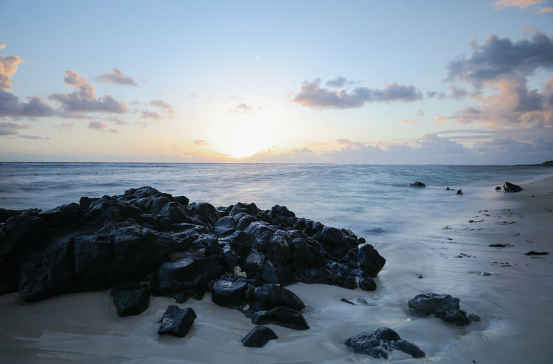 Mauritius island holidays At The Beach Black Blue Sky Mauritius Island  Moring Rocks Some Clouds Sunrise