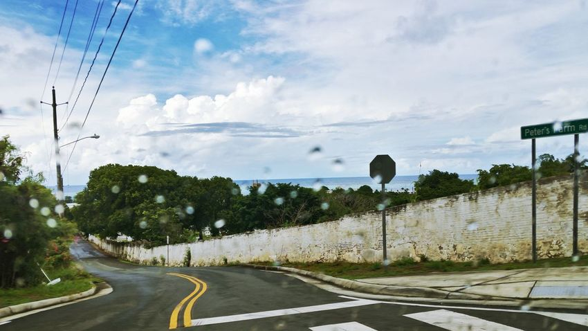 Clouds And Sky On The Road A Rainy Day Old Wall Street Road Signs Outdoors Peter's Farm St.Croix, US Virgin Islands