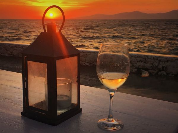 Mykonos,Greece Alcohol Beauty In Nature Drink Food And Drink Glass Glass - Material Nature No People Orange Color Refreshment Sea Sky Still Life Sunset Table Transparent Water Wine Wineglass