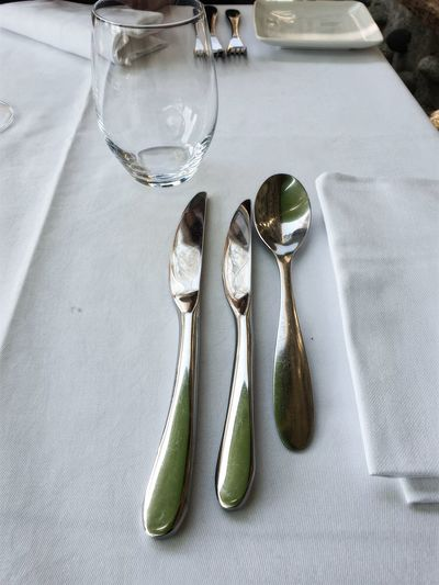 High angle view of cutlery on dining table