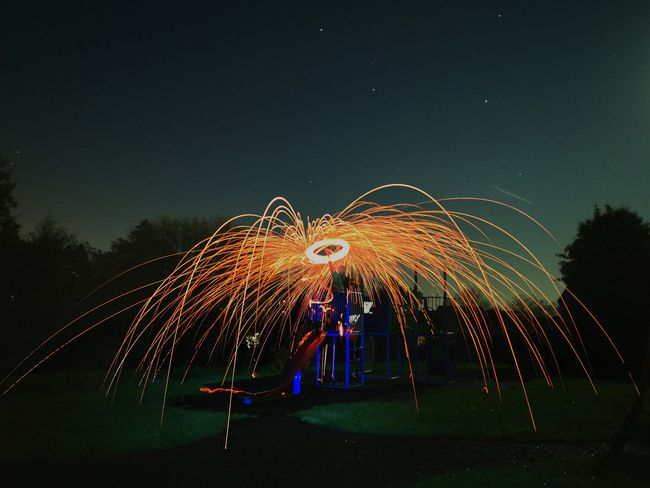 Night Long Exposure Celebration Motion Firework Display Illuminated Blurred Motion Light Trail Arts Culture And Entertainment Outdoors Sky Wire Wool EyeEm Best Shots Huawei Photography EyeEm Selects Low Angle View Oo Orange Color Long Exposure Shot