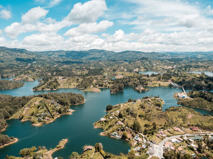Beautiful Guatape Lake Architecture Beauty In Nature Day High Angle View Nature No People Outdoors Plant Scenics - Nature Sea Tranquil Scene Tree Water