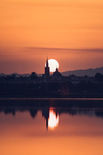 Sunset Reflection Sky Sunset Water Orange Color Silhouette Nature Built Structure Architecture Scenics - Nature Beauty In Nature Lake Building Exterior Outdoors No People Tranquility Travel Destinations Dusk Waterfront Romantic Sky A New Perspective On Life Capture Tomorrow