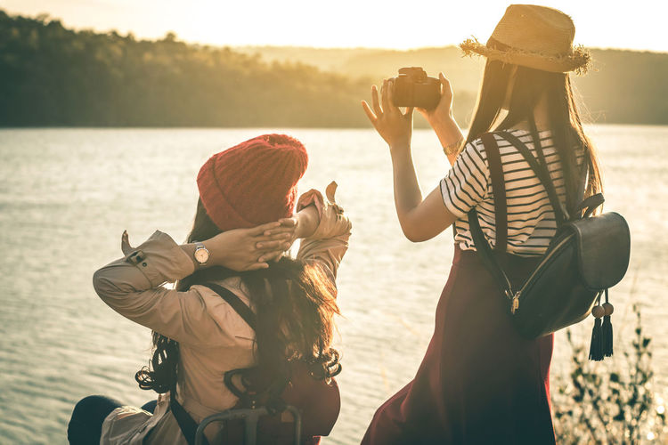 Travel Backpack Backpacker Beauty In Nature Friendship Landscape Lifestyles Nature Outdoors Sunlight Sunset Vacations Water Women