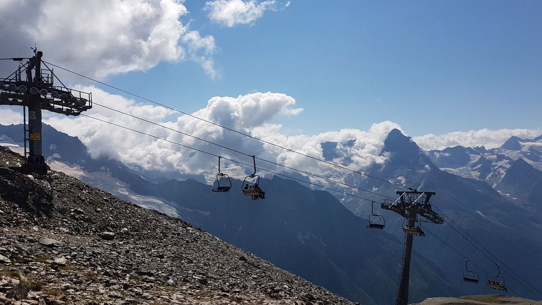 The cable car on Dombai EyeEm Selects Snow Mountain Technology Sky Cloud - Sky Ski Lift Verbier Overhead Cable Car Telephone Line Power Supply Snowcapped Mountain Electricity Tower Electricity Pylon Power Line  Telephone Pole Steel Cable Ski Track Cable Cable-stayed Bridge Electric Pole Electrical Grid Fuel And Power Generation Ski Resort  High Voltage Sign Power Cable Fuse Box Wire Electricity