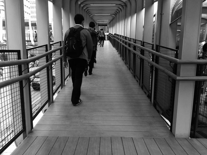 Perspective Diminishing Perspective Architectural Feature Full Length Men Back City Rear View Walking Railing Gate Architecture Bridge - Man Made Structure Arch Bridge Footbridge vanishing point The Way Forward Human Back