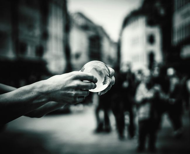 Close-Up Of Hands Holding Transparent Ball