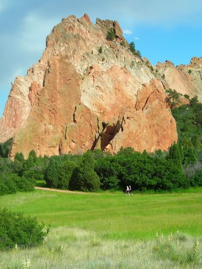Garden of the Gods Garden Of The Gods Colorado Springs Outcroppings. Greenery. Lush. Gorgeous. Rock Formations. Close To Town. Convenient. Beautiful. Dog Friendly Popular.. Outside Climbing. Fun. Men. Women. Hikers. Hiking. Posing Pine Trees. Sunny. Clear Skies.