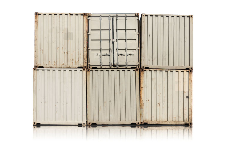 Metallic cargo containers against white background