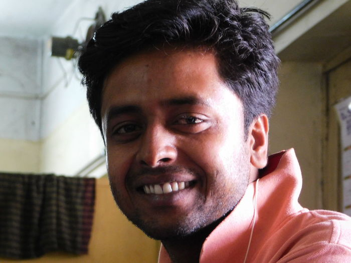 Close-up portrait of smiling young man at home