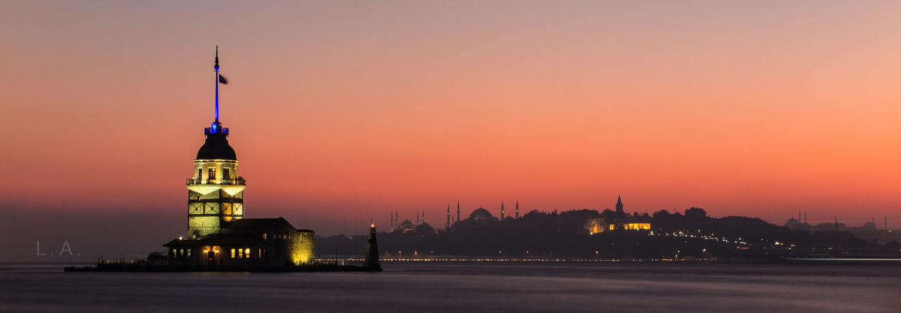 Illuminated maiden tower at bosphorus during sunset