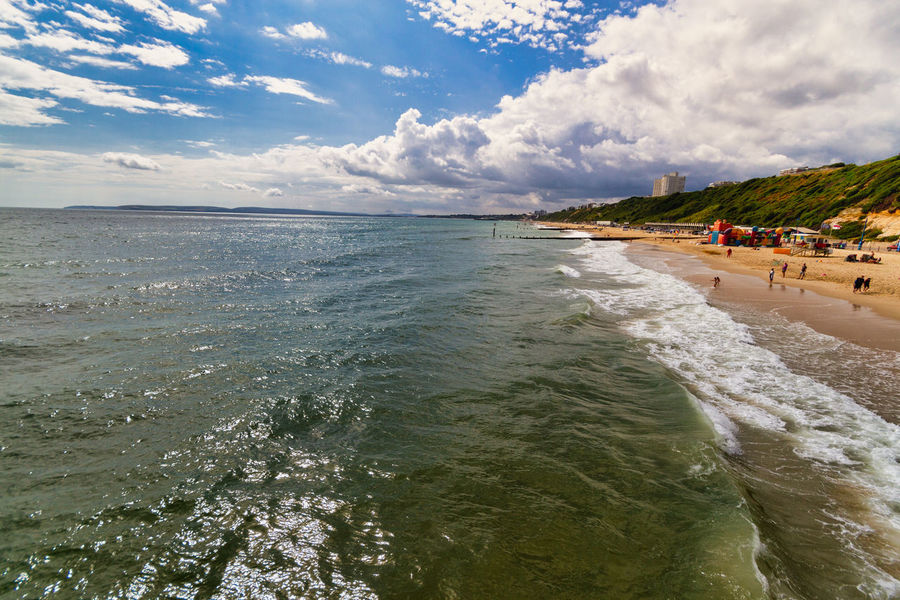 Boscombe another side Bournemouth Aquatic Sport Beach Beauty In Nature Boscombe Boscombe Pier  Cloud - Sky Day Holiday Horizon Over Water Incidental People Land Motion Nature Outdoors Scenics - Nature Sea Sky Sport Surfing Travel Trip Vacations Water
