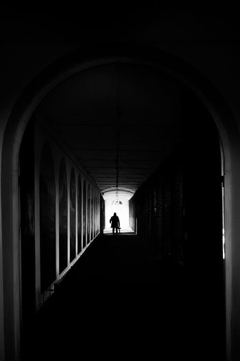 When You Say Nothing At All Fujifilm_xseries Streetphotography LONDON❤ London Architecture Arch Built Structure Indoors  Real People Arcade One Person Silhouette Men Corridor Day The Way Forward Direction Full Length Building Walking Standing Rear View Lifestyles Dark Light At The End Of The Tunnel Ceiling Architectural Column