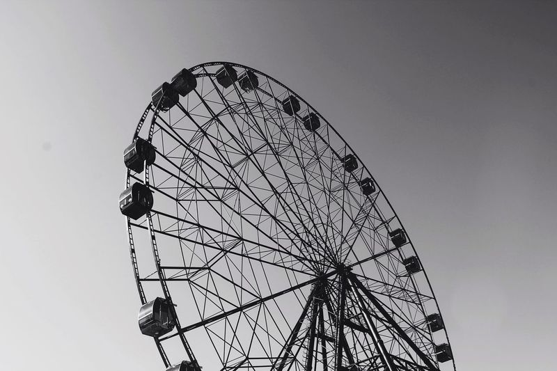 Amusement Park Ferris Wheel Low Angle View Arts Culture And Entertainment Amusement Park Ride Big Wheel Sky No People Day Clear Sky Outdoors Stories From The City EyeEmNewHere