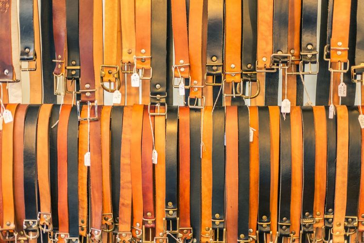 A lot of leather belts in a clothing shop in italy Dresses EyeEm Best Shots EyeEm Selects EyeEm Gallery EyeEmBestPics EyeEmNewHere Italianstyle Leather Accessories Artigianato Backgrounds Belts Close-up Clothing Day Full Frame Geometry Handmade In A Row Large Group Of Objects Lines And Shapes Metallic No People Parallel Lines Texture