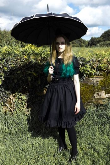 Emily in Wonderland • pt 2 Happiness One Person Young Women Young Adult Looking At Camera Black Color Gothic Portrait One Young Woman Only Blond Hair Sunlight Growth Lifestyles Outdoors Day Nature Nature Photography Green Green Color Magic Petticoat Long Hair