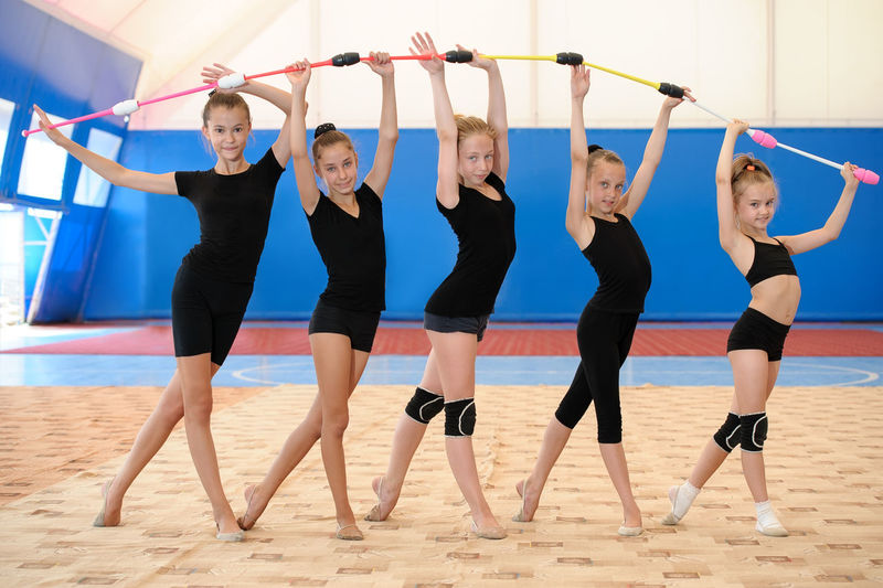 Arch Bow Caucasian Cheerful Child Exercise Female Girl Group Gym Gymnastics Smile Sport Sportive Sportswoman Sporty Student Teenager