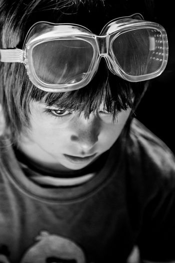 Close-Up Of Boy With Eyewear Looking Down