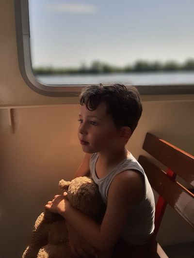 Side view of boy in boat