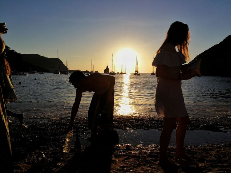 Ibiza Benirrás Ibiza Benirrás Beach Idyll Insel Mittelmeer Water Sea Sunset Full Length Beach Young Women Standing Women Silhouette Sky Coast