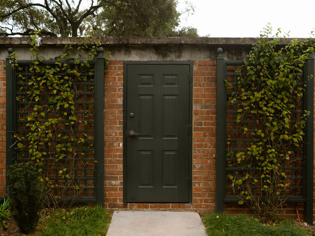 Architecture Built Structure Building Exterior Door Plant Entrance No People Closed House Day Security Tree Safety Residential District Green Color Nature Outdoors Garage