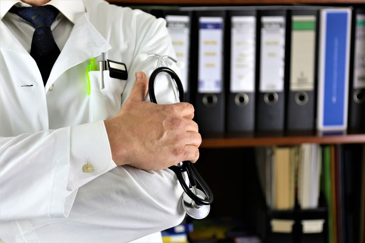 Midsection Of Doctor Holding Stethoscope
