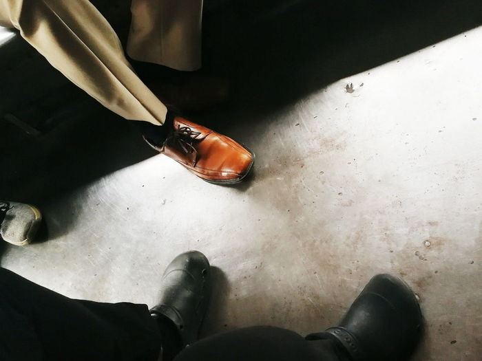 Formal | Informal Low Section Only Men Lifestyles Close-up Feet Shoes Leather Shoes Crocs Transportation Footwear Be. Ready. Business Stories