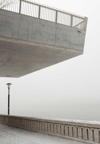 Danube river promenade on a misty day Architecture Built Structure Railing Water No People Nature Sea Outdoors Sky Building Exterior Street Balustrade High Angle View Absence Clear Sky Footpath Street Light Concrete Promenade Mist Fog Minimalism Copy Space