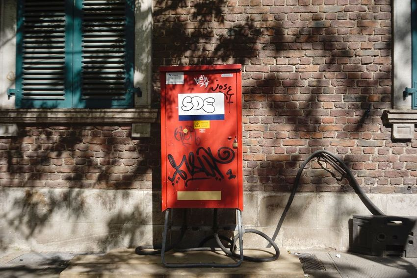 Junction Box Communication Wall - Building Feature Text Sign Graffiti Architecture Built Structure Building Exterior Wall No People Day Brick Wall Outdoors Street Art Western Script Building Red